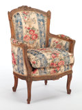 Furniture : French, A LOUIS XV-STYLE UPHOLSTERED AND CARVED WALNUT ARMCHAIR . Circa1930. 41-1/2 x 31-1/2 x 22 inches (105.4 x 80.0 x 55.9 cm). ...