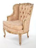 Furniture , A LOUIS XV-STYLE UPHOLSTERED AND CARVED PAINTED ARMCHAIR . Circa 1930. 37-1/2 x 26-3/4 x 23 inches (95.3 x 67.9 x 58.4 cm). ...