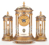 A THREE PIECE FRENCH GILT BRONZE, CLOISONNÉ AND CHAMPLEVÉ ENAMEL CLOCK GARNITURE Maker unknown, France, ci...