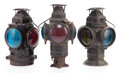 Lighting:Lamps, THREE ADLAKE RAILROAD LANTERNS . 20th century. Marks: THE ADLAKE ON-SWEATING LAMP, CHICAGO. 15-3/4 inches high (40.0 cm)... (Total: 3 Items)