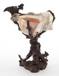 Decorative Arts, Continental, A CONTINENTAL PATINATED BRONZE MOUNTED SHELL . Circa 1900. 9 incheshigh (22.9 cm). ...