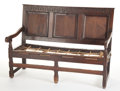 Furniture , AN ENGLISH OAK THREE-PANEL ROPE SEAT SETTLE. 18th century. 39-3/4 x 55 x 26 inches (101.0 x 139.7 x 66.0 cm). The Elton M....