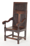 Furniture , A FRENCH GOTHIC-STYLE OAK ARM CHAIR . 16th century (in part) . 45 x 20-3/4 x 21 inches (114.3 x 52.7 x 53.3 cm). Later panel...