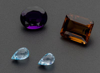 Four Unmounted Gemstones