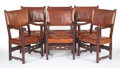 Furniture , A GROUP OF SIX SPANISH-STYLE LEATHER ARMCHAIRS. Late 19th century. 42-1/2 x 25 x 21 inches (108.0 x 63.5 x 53.3 cm). The E... (Total: 6 Items)