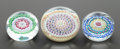 Decorative Arts, French:Other , A GROUP OF THREE BACCARAT CASED GLASS PAPERWEIGHTS . Circa 1987.Marks (largest): BACCARAT FRANCE 42 1987 . 2-1/4 inches...(Total: 3 Items)