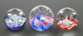 Decorative Arts, British:Other , A GROUP OF THREE CAITHNESS CASED GLASS PAPERWEIGHTS . Circa 1996.Marks: CAITHNESS SCOTLAND, MINIATURE FLOWER '96 (left ...(Total: 3 Items)