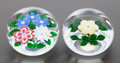 Decorative Arts, French:Other , A GROUP OF TWO ST. LOUIS CASED GLASS PAPERWEIGHTS . Circa 1986.Marks to bouquet: SL 1986 (signature cane). 2-1/4 inches...(Total: 2 Items)