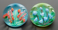 Decorative Arts, French:Other , A GROUP OF TWO ST. LOUIS CASED GLASS PAPERWEIGHTS . Circa 1990.Marks to orange bouquet: SL 1990 (signature cane), 112...(Total: 2 Items)