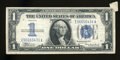 Error Notes:Attached Tabs, Fr. 1606 $1 1934 Silver Certificate. Very Fine....