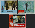 "Movie Posters:Action, James Bond Group Lot (United Artists and Columbia, 1967-1977). Lobby Cards (3) (11"" X 14"") and Pressbook (Multiple Pages). A... (Total: 4 Items)"