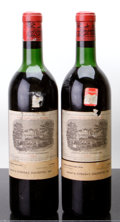 Red Bordeaux, Chateau Lafite Rothschild 1964 . Pauillac. 1ts, 1hs, 2bsl, 2tl. Bottle (2). ... (Total: 2 Btls. )