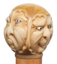A CARVED IVORY AND WOOD TRIPLE FACE CANE Circa 1900 34-1/2 inches length overall (87.6 cm)