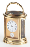Timepieces:Clocks, A GILT BRONZE OVAL CARRIAGE CLOCK WITH REPEATER . Early 20thcentury. 6 x 5 x 4 inches (15.2 x 12.7 x 10.2 cm) (handle down)...