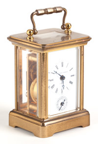 A MINIATURE SWISS MADE MATTHEW NORMAN BRASS CARRIAGE CLOCK Early 20th century Retailed by Matthew Norman, Lond