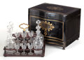 Decorative Arts, French:Other , A NAPOLEON III EBONIZED WOOD, BRASS AND MOTHER-OF-PEARL CARVE DELIQUEUR WITH CUT GLASS DECANTERS AND CORDIALS. Circa 1860. ...(Total: 16 Items)