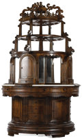 American, A Massive American Walnut Circular Exhibition Cabinet. . Unknownmaker, American. Circa 1853. Walnut veneer and solids on pi...