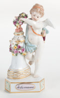 Ceramics & Porcelain, A MEISSEN PORCELAIN FIGURE: CUPID CROWNING HEARTS . Circa 1900. Marks: (crossed swords) F3. 5-1/2 inches high (1...