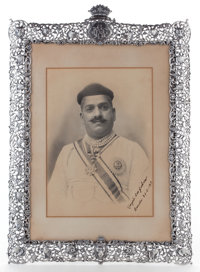 SIGNED AND INSCRIBED PHOTOGRAPH OF MAHARAJA SAYAJIRAO OF BARODA IN INDIAN SILVER PRESENTATION FRAME Maker unknown