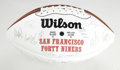 Football Collectibles:Balls, 1994 San Francisco 49ers Team Signed Football. On the leather of the offered Wilson 75th Anniversary souvenir football we f...