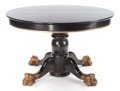 Furniture , AN EBONIZED AND GILT DINING TABLE . 20th century. 28 inches high x 45 inches diameter (71.1 x 114.3 cm). ...