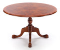 Furniture , A MAHOGANY DINING TABLE . 20th century. 30 inches high x 46-1/2 inches diameter (76.2 x 118.1 cm). ...