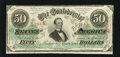 Confederate Notes:1863 Issues, T57 $50 1863. An issue date of January 1864 is found on this $50that had a small portion of the cut cancel fall by the ways...