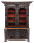 Furniture : Continental, AN ITALIAN RENAISSANCE-STYLE GLAZED CARVED WALNUT CABINET . Late17th century. 86-3/4 x 66-1/2 x 23 inches (220.3 x 168.9 x ...(Total: 2 Items)