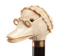 Decorative Arts, Continental:Other , CARVED IVORY AND WOOD MOTHER GOOSE CANE . Circa 1900. 35-3/4 inchesoverall length (90.8 cm). ...