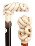 Decorative Arts, Continental:Other , TWO CARVED IVORY AND WOOD SNAKE CANES . Circa 1900. 38-1/2 inchesoverall length of knob cane (97.8 cm) . 38 inches overall...(Total: 2 Items)
