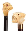 Decorative Arts, Continental:Other , TWO IVORY AND WOOD DOG CANES. Circa 1900. 37-1/4 inches overalllength (94.6 cm). 35 inches overall length (88.9 cm). ... (Total: 2Items)