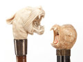 Decorative Arts, Continental:Other , TWO IVORY AND WOOD EXOTIC ANIMAL CANES . Circa 1900 . 37-1/4 incheslength overall of tiger cane (94.6 cm). 36 inches length... (Total:2 Items)