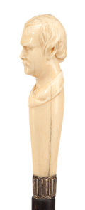 Decorative Arts, Continental:Other , CARVED IVORY AND WOOD PORTRAIT CANE. Circa 1900. 36 inches overalllength (91.4 cm). ...