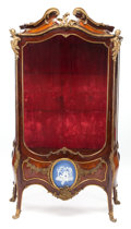 Furniture : French, A FRENCH LOUIS XV-STYLE GLAZED KINGWOOD AND TULIPWOOD VITRINE WITHFIGURAL GILT BRONZE MOUNTS AND BISQUE PLAQUE . Circa 1900...