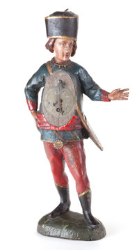 A CONTINENTAL POLYCHROME CARVED WOOD FIGURAL CLOCK 19th century 19 inches high (48.3 cm)