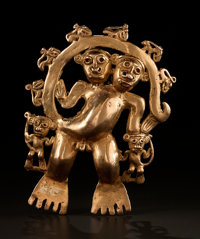 A LARGE QUIMBAYA GOLD PENDANT REPRESENTING A COMPOSITE HUMAN/ANIMAL CREATURE WITH TWO HEADS c. 1200 - 1400 AD