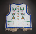 American Indian Art:Beadwork and Quillwork, A SIOUX BOY'S BEADED HIDE VEST. c. 1900...