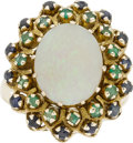 Jewelry, AN OPAL, SAPPHIRE, EMERALD, GOLD RING. The ring features an opal cabochon measuring 15.10 x 11.90 x 4.10 mm, enhanced by rou...