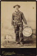 "Photography:Cabinet Photos, ""DODGE CITY"" KANSAS COWBOY BAND DRUMMER, ca 1885. Capitalizing onits image as the ""Cowboy Capital of the United States,"" Do...(Total: 1 Item)"