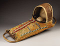 American Indian Art:Beadwork, AN APACHE BEADED HIDE CRADLE. . c. 1900. ...