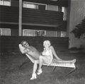 Photographs, DIANE ARBUS (American, 1923-1971). Southbay Singles: Couple on a Chaise Lounge, 1970. Gelatin silver, printed by Neil Se...