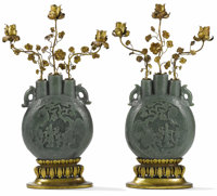 A Pair of Chinese Jade Pilgrim Flasks Unknown maker, China 19th century Carved jade Unmarked 30 in
