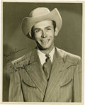 "Music Memorabilia:Autographs and Signed Items, Hank Williams Signed Photo. A b&w 8"" x 10"" photo of the lateCountry music legend with a rare inscription and autograph by h...(Total: 1 Item)"