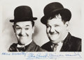 Autographs:Celebrities, Stan Laurel and Oliver Hardy Photo Signed...