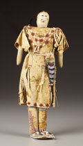 American Indian Art:Beadwork, A CHEYENNE/ARAPAHO BEADED HIDE FEMALE DOLL. . c. 1890. ...