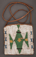 American Indian Art:Beadwork and Quillwork, A UTE BEADED LEATHER POUCH...