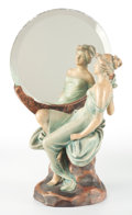 Ceramics & Porcelain, Continental:Modern  (1900 1949)  , AN AUSTRIAN POTTERY FIGURAL MIRROR. Early 20th century. Marks:7602, BB, C (in shield). 16-1/2 inches high x 9-1/2 inche...