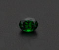 Estate Jewelry:Unmounted Gemstones, Unmounted Tsavorite Garnet. The oval-shaped tsavorite garnet measures 7.68 x 5.83 x 4.74 mm and weighs 1.62 carats. . Cond...