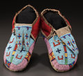 American Indian Art:Beadwork and Quillwork, A PAIR OF CROW PICTORIAL BEADED BUFFALO HIDE MOCCASINS. c. 1880...