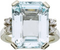 Estate Jewelry:Rings, AN AQUAMARINE, DIAMOND, WHITE GOLD RING. The ring features anemerald-cut aquamarine measuring 15.75 x 12.05 x 7.05 mm and w...